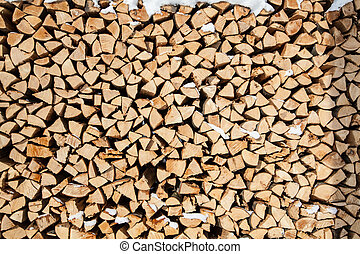 pile of firewood. snowy firewoods in winter forest