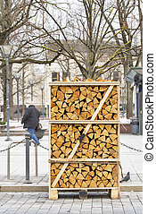 Pile of firewood stacked on the street