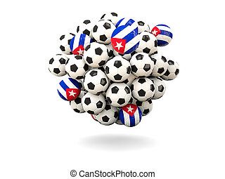 Pile of footballs with flag of cuba