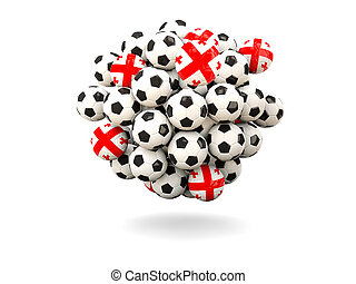 Pile of footballs with flag of georgia