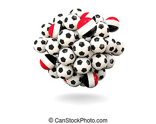 Pile of footballs with flag of yemen