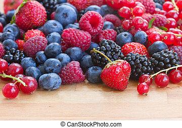 pile of fresh berries on table