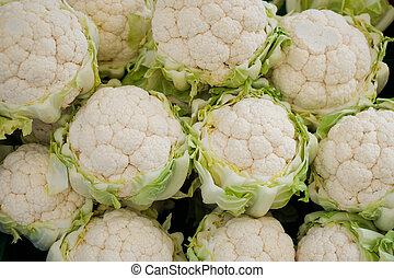 Pile of fresh cauliflower for sale at a market