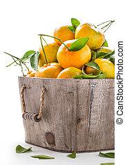 pile of fresh orange in wooden bucket