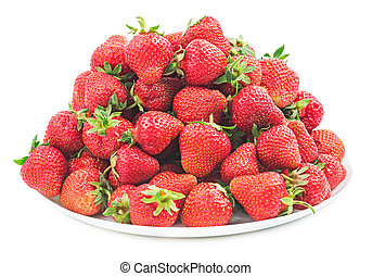 Pile of fresh red strawberry on a white plate isolated