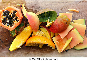 Pile of Fruit Skinds and Scraps for Compost in Garden