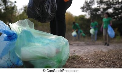 Pile of garbage bags with collected plastic waste