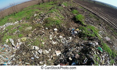 Pile of garbage spring - Field forest near landing burn...