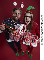 Pile of gifts held by couple