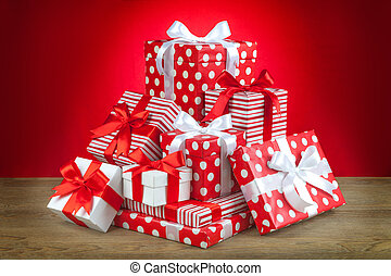 pile of gifts on the red background.