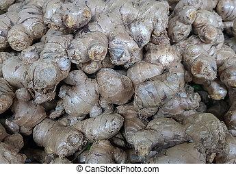 pile of ginger in vegetable market for sale