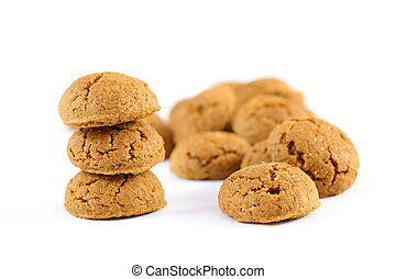 Pile of ginger nuts (pepernoten) isolated on white background