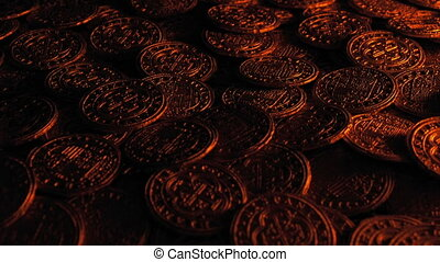 Gold coins illuminated in fire light