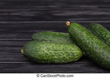 Pile of green fresh cucumbers.