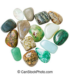 pile of green natural mineral gemstones isolated