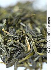 Pile of green tea on white background. Shallow dof