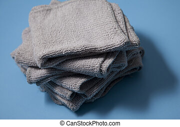 Pile of grey facecloths