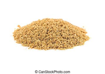 Pile of ground coriander isolated on white background