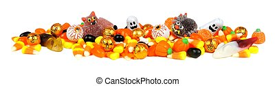 Pile of Halloween candy - Long border of assorted Halloween...