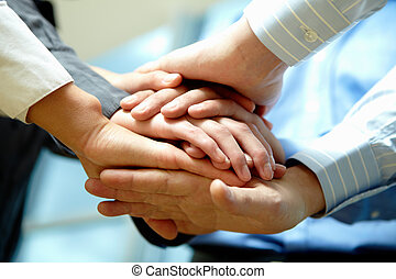 Pile of hands - Image of business people hands on top of...