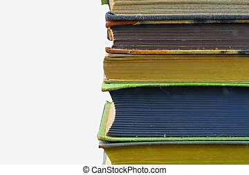 Pile of hardcover vintage books isolated with copy space. White background. Close-up
