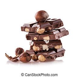 Pile of hazelnut chocolate on white background - Pile of...
