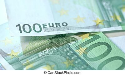 Pile of Hundred Euro Banknotes on a Table - A pile of...
