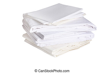 pile of ironed white bed sheets - pile or stack of cotton...