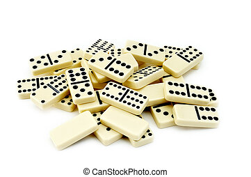 Pile of ivory dominos on white