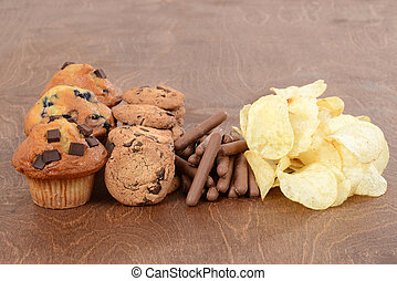 Pile of junk food on wood