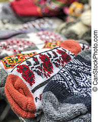 pile of knitted woven socks at a market