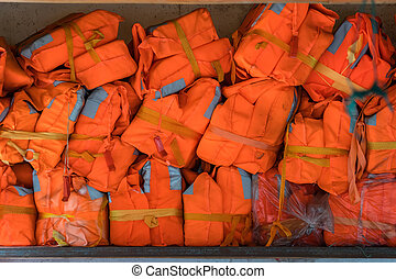 Pile of life vests for passengers on the boat
