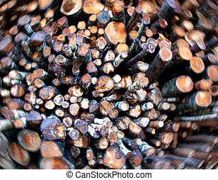 Background of pile of logs with blurred edge