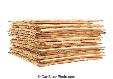 Pile of machine made matza flatbread, composition isolated...