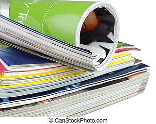 Many colourful magazines on the white background.
