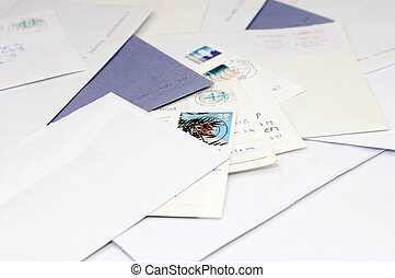 Pile of mail - A pile of envelops and postcards, bills on a...