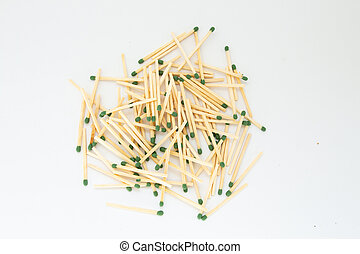 pile of matches on a white background