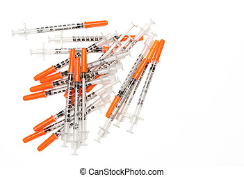 Pile of Medical syringes on white background
