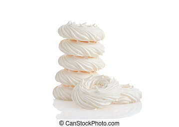 pile of meringue nests on white