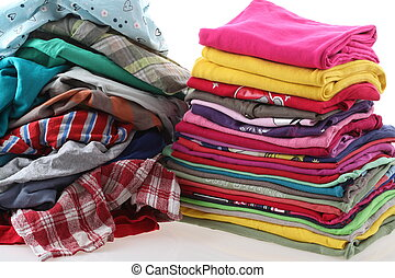 Pile of messy and ironed clothes - Heap of clothes with ...