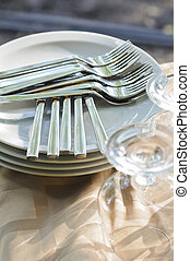 Pile of metal forks on the white plates