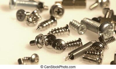 Pile of metal screws closeup
