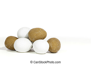 Pile of mini Easter eggs against white background with copy space.