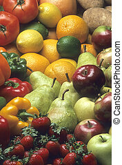 Pile of mixed fruits and vegetables including apples, pears, strawberries, oranges, lemons, limes, peppers, and potatoes.