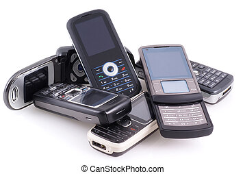 Pile of mobile phones. - Bunch of cell phones isolated on...