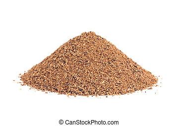 Pile of Nutmeg powder (Myristica fragrans) isolated on white...