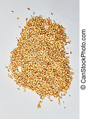 Pile of oat flakes on white background.