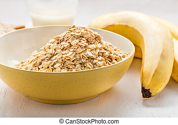 pile of oatmeal in a bowl with banana