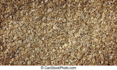 Pile Of Oats Turning Slowly - Overhead shot of oats in a...