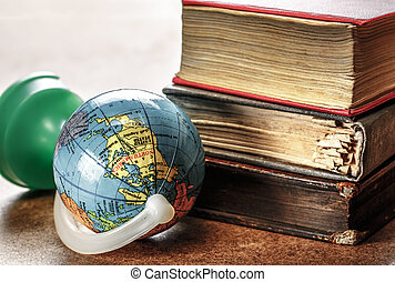 Pile of old books and globe